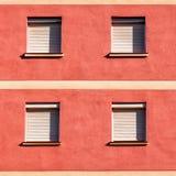 Fasada budynek z cztery zamykał okno Obrazy Royalty Free