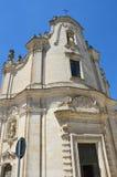 Fasaden med skelett- lättnad av skärseldkyrkan i Matera, Basilicata, Italien royaltyfri bild