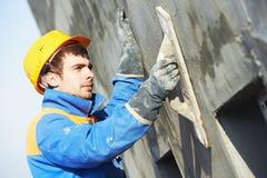 Fasadowy budowniczego gipsiarz przy pracą Zdjęcia Stock
