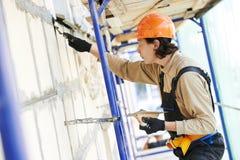 Fasadowy budowniczego gipsiarz przy pracą Zdjęcia Royalty Free