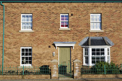 Fascade of a new house with green door Royalty Free Stock Image