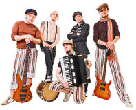 Fascia musicale con i loro strumenti su bianco Fotografia Stock Libera da Diritti