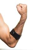 Fasciatura del gomito su un man& x27; isolato a mano di s Fotografie Stock Libere da Diritti