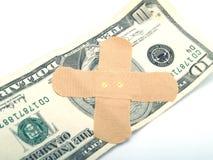 Fasciatura su soldi Immagine Stock Libera da Diritti