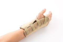 Fasciatura sulla mano umana di lesione immagini stock