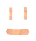 Fasciature dell'adesivo del fronte di smiley Fotografia Stock Libera da Diritti