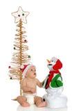 Fascinado con el juguete de la Navidad Foto de archivo