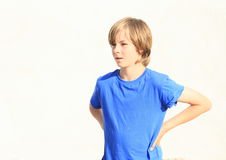 Fascinated boy. Face of a surprised little boy in blue t-shirt stock photo
