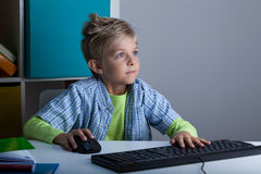 Fascinated boy playing Royalty Free Stock Photography