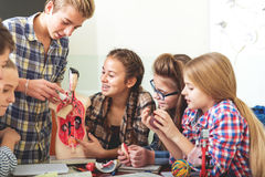 Fascinated lesson with interested teenagers Stock Photo