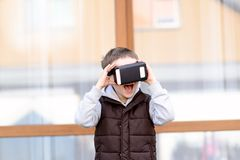 Fascinated little boy  using VR virtual reality goggles Stock Photos