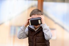 Fascinated little boy watching movie in VR virtual reality goggles Royalty Free Stock Photography