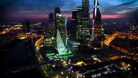 Amazing aerial drone view on bright evening night Moscow city illumination in busy metropolis downtown cityscape stock video footage