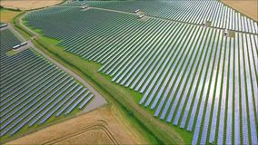Breathtaking aerial drone view on futuristic modern urban green field eco solar energy panel renewable power station. Fascinating aerial drone view on futuristic stock video