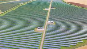 Picturesque aerial drone shot of futuristic modern urban green field eco solar energy panel renewable power station. Fascinating aerial drone view on futuristic stock video footage
