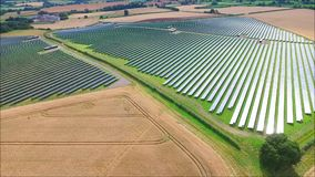 Stunning aerial drone shot of futuristic modern urban green field ecology solar energy panel renewable power station. Fascinating aerial drone view on futuristic stock video footage