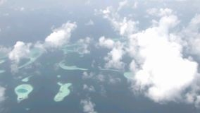 Fascinating aerial helicopter flyover white fluffy clouds in sky over wild nature turquoise lake green tropical forest. Fascinating aerial helicopter flight over stock video