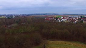 Beautiful aerial 4k drone flight over calm small city cityscape with big mirror surface lake in park on cloudy day. Fascinating aerial 4k drone flight over calm stock footage