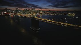 Fascinating aerial shot of big steel Golden Gate bridge San Francisco downtown skyline illuminated night light cityscape. Fascinating aerial drone shot of huge stock video