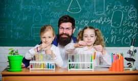 Fascinating biology lesson. Man bearded teacher work with microscope and test tubes in biology classroom. School biology stock image
