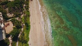 Fascinating blue waters of pacific ocean near clean sandy coast and magnifincent resort hyatt with beautiful nature on stock video footage