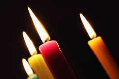 Multicolored candles burning Stock Images