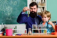 Fascinating chemical reaction. Interesting school classes. School education. School chemistry experiment. Teacher and. Pupils test tubes in classroom stock photography