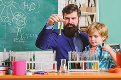 Fascinating chemical reaction. Interesting school classes. School education. School chemistry experiment. Teacher and. Pupils test tubes in classroom stock image