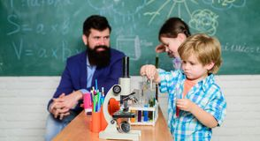 Fascinating chemical reaction. Teacher and pupils with test tubes in classroom. Interesting school classes. School royalty free stock image