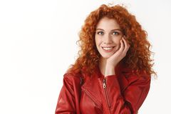 Fascinating day, wellbeing concept. Gorgeous natural ginger girl blue eyes curls touch cheek silly smiling enthusiastic. Listen interesting story standing white stock image