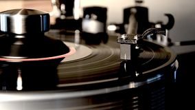 Vintage retro vinyl album black old record player disc gramophone on turntable in gorgeous detailed close up loop view. Fascinating detailed close up loop view stock footage