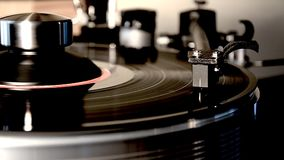 Incredible detailed close up loop shot of vintage retro vinyl album black old record player gramophone on turntable. Fascinating detailed close up loop view on stock footage
