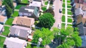 Fascinating drone panorama aerial tilt shift view on tiny houses villas in suburb town village neighborhood. Fascinating drone aerial tilt shift view on tiny stock video footage