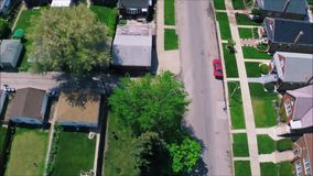 Amazing drone panorama aerial tilt shift view on tiny houses villas in suburb town village neighborhood. Fascinating drone panorama aerial tilt shift view on stock footage