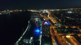 Fascinating 4k aerial drone panorama flight over highway road by the river in bright night light Philadelphia cityscape. Fascinating 4k aerial drone panorama stock video
