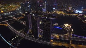 Magnificent 4k aerial drone view on big city Singapore by ocean metropolis downtown in bright night light illumination stock video footage
