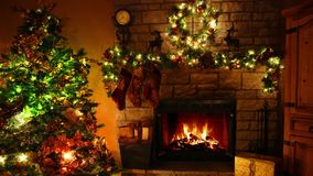 Incredible 4k shot of firewood flame burning fireplace loop in cosy festive Christmas tree New Year decoration Noel room