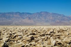 Fascinating landscape, mountains, blue sky - the mystical Devil`s golf course, Death Valley National Park royalty free stock image