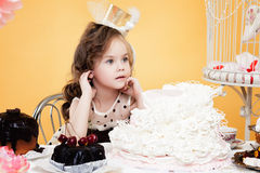 Fascinating little lady posing with tasty treats Stock Photos