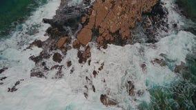 Aerial shot raging waves splashing against big stones on island maui,hawaii stock video footage