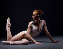 Fascinating red-haired ballerina posing in studio Royalty Free Stock Images