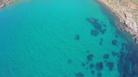Fascinating seabed, underwater rLagoon. View from the air, sea. Picturesque sea landscape. Seacoast. Malta. Turquoise ocean water. Fascinating seabed stock footage