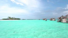 Wonderful shot of turquoise calm ocean water in tropical seaside luxury resort paradise Maldives island seascape skyline. Fascinating shot of turquoise calm stock video
