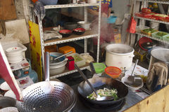 Fascinating streets and trades of Shanghai, China: typical street restaurant with its own colors and flavors Royalty Free Stock Photography