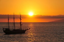 Fascinating sunset and the piracy ship Stock Photos