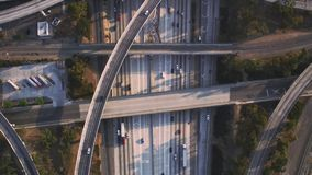 Fascinating top aerial drone panorama flight over busy highway multiple vehicle road with traffic cement junction bridge. Fascinating top aerial drone panorama stock footage