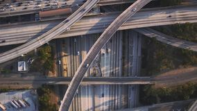 Magnificent top aerial drone panorama flight over busy highway multiple vehicle road with traffic cement junction bridge. Fascinating top aerial drone panorama stock video footage