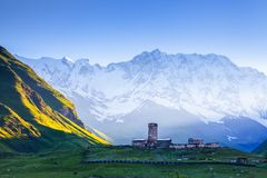 A fascinating view on Ushguli village at the foot of snow-capped Mt. Shkhara. Location place Lamaria Church Jgrag, Georgia, Europe Stock Images