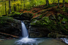 Fascinating waterfall in the mountains stock photography