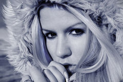 Fascinating winter portrait of blonde in a hood Royalty Free Stock Images
